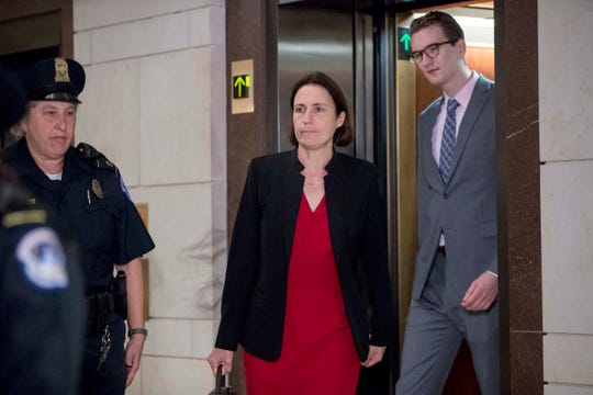 Former White House adviser on Russia, Fiona Hill, arrives on Capitol Hill in Washington, Monday, Oct. 14, 2019, as she is scheduled to testify before congressional lawmakers as part of the House impeachment inquiry into President Donald Trump.