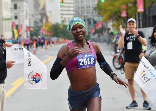 Joan Massah, the winner of the women's marathon, crosses the finish line.