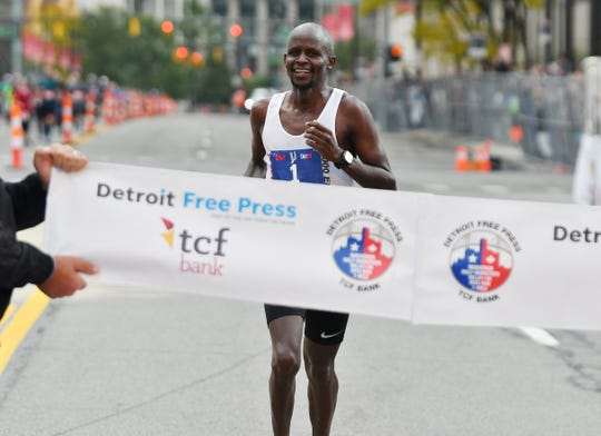 Christopher Chipsiya, the winner of the men's marathon, crosses the finish line.