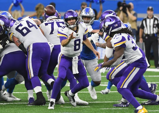 Vikings quarterback Kirk Cousins laterals back the ball to running back Dalvin Cook he heads up field for a gain in the fourth quarter Sunday at Ford Field.