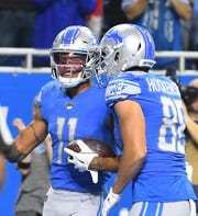 Lions' Marvin Jones celebrates with teammates T.J. Hockenson after his third touchdown reception of the first half Sunday.