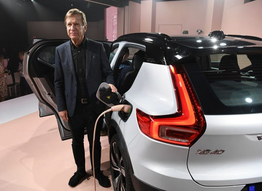 Hakan Samuelsson, President and CEO of Volvo Cars, stands by the electric plug of the XC40 after Volvo Cars revealed its first fully electric car, Wednesday.