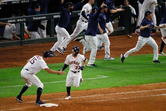 Houston Astros' Jose Altuve rounds the bases after a two-run walk-off to win Game 6 of the American League Championship Series.