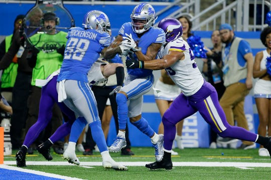 Lions wide receiver Marvin Jones (11) pulls ahead of Vikings outside linebacker Anthony Barr (55) to score a touchdown during the first half Sunday in Detroit.