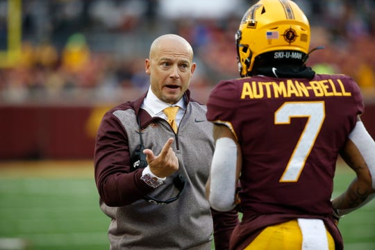 Head coach P.J. Fleck, left, has Minnesota unbeaten, but a daunting remaining schedule awaits the Golden Gophers.