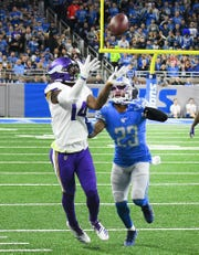 Vikings' Stefon Diggs gets ahead of Lions' Darius Slay for a completion in the second quarter.