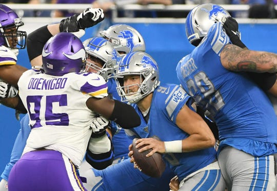 Lions quarterback Matthew Stafford sees the pocket crumbling around him against the Vikings.