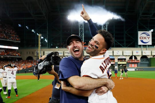 The Houston Astros' Jose Altuve and  Justin Verlander celebrate after winning Game 6 of the ALCS.