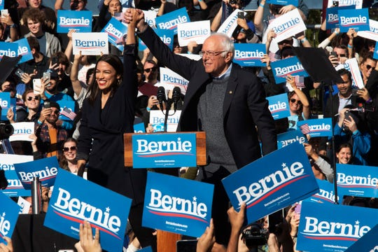 Democratic presidential candidate Sen. Bernie Sanders, I-Vt., right, is introduced by Rep. Alexandria Ocasio-Cortez, D-N.Y., during a campaign rally, Saturday, Oct. 19, 2019, in the Queens borough of New York.