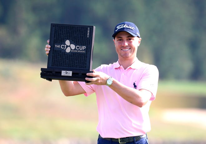 Justin Thomas poses with the trophy after winning the CJ Cup on Sunday.