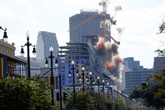 New Orleans officials set off several explosions Sunday intended to topple two cranes that had been looming precariously over the ruins of a partially collapsed hotel, but only one crane appeared to make it to the ground.