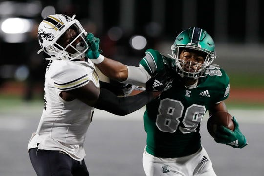Eastern Michigan wide receiver Arthur Jackson III (89) stiff arms Western Michigan cornerback Anton Curtis during the first half on Saturday.