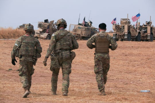 American military convoy stops near the town of Tel Tamr, north Syria, Sunday.