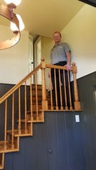 David Mayer on the steps to a storage area above the Red Geranium dining room.