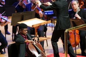 Guest conductor Scott Seaton leads the Evansville Philharmonic Orchestra with a featured performance from cellist Sterling Elliott.