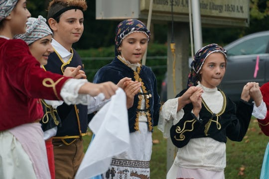 The intermediate dance group performs in traditional costume at the Tallahassee Greek Food Festival