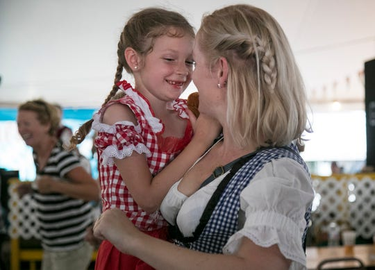 Nadine Lopin dances with her daughter Summer, 6, at Oktoberfest on Saturday, October 19, 2019, in Cape Coral.