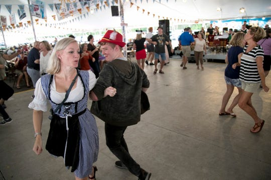 Nadine Lopin dances with her son Colin, 14, at Oktoberfest in Cape Coral on Saturday, October 19, 2019