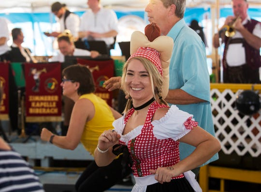 Anna Jackson does the chicken dance at Oktoberfest at the German American Social Club on Saturday, October 19, 2019, in Cape Coral.