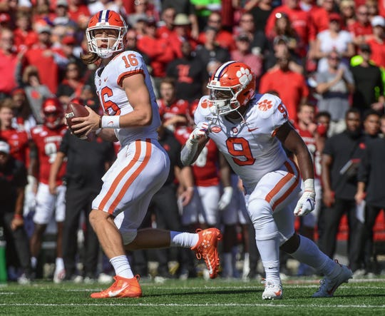 Clemson quarterback Trevor Lawrence (16) passes near running back Travis Etienne (9) during the third quarter at Cardinal Stadium in Louisville, Kentucky Saturday, October 19, 2019.