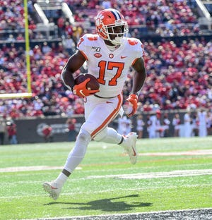 Clemson wide receiver Cornell Powell (17) scores during the fourth quarter at Cardina Stadium in Louisville, Kentucky Saturday, October 19, 2019.
