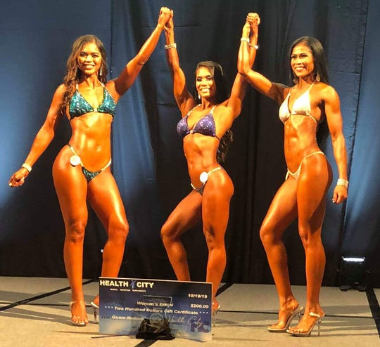 The Bikini winners at the 2019 NPC Michelob Ultra Guam National Bodybuilding Championships held Oct. 19 at the Sheraton Laguna Resort Guam. Jeralyn Mesa, center, Class A and overall, Muneka Taisipic, left, Class C; and Marithir O'Conner, right, Class B.