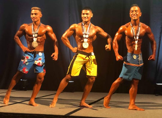 The Men's Physique top finishers at the 2019 NPC Michelob Ultra Guam National Bodybuilding Championships held Oct. 19 at the Sheraton Laguna Resort Guam. Ian Milan, middle, first place; Joewell Baisa, left, second; and Lucas Rabanal right, third.