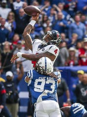 Indianapolis Colts defensive end Jabaal Sheard (93) sacks Houston Texans quarterback Deshaun Watson (4) during the second quarter of their game Lucas Oil Stadium in Indianapolis in NFL Week 7, Sunday, Oct. 20, 2019.