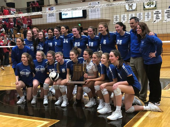 Hamilton Southeastern's volleyball team poses with the sectional trophy after sweeping Fishers on Saturday night.