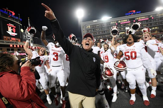 Indiana coach Tom Allen, center, celebrates with his team after an NCAA college football game against Maryland, Saturday, Oct. 19, 2019, in College Park, Md.
