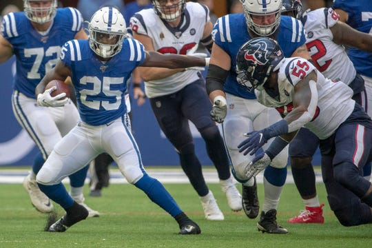 Marlon Mack of the Indianapolis Colts sidesteps a Houston defender Sunday at Lucas Oil Stadium, but the Colts running game was stymied and they took to the air to win.