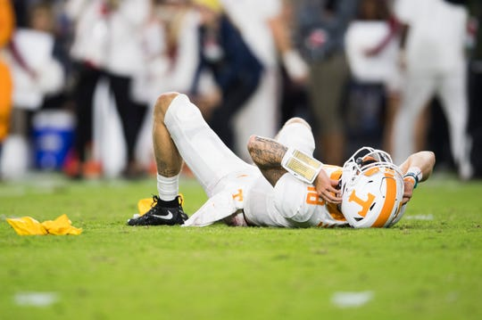 Tennessee quarterback Brian Maurer (18) is shaken up during a game between Tennessee and Alabama at Bryant-Denny Stadium, Saturday, Oct. 19, 2019.