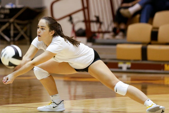 McCutcheon's Emily Brown (8) hits the ball during the second set of an IHSAA girls volleyball sectional championship match, Saturday, Oct. 19, 2019 in Lafayette. McCutcheon won, 3-0 (25-10, 25-10, 25-14).