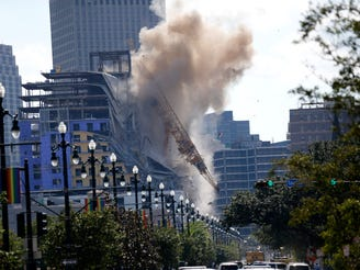 Hard Rock Hotel: Demolition blasts one crane near French Quarter, other dangles