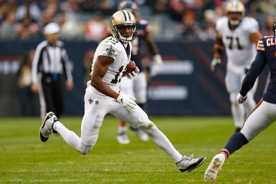 New Orleans Saints wide receiver Michael Thomas (13) runs against the Chicago Bears during the first half of an NFL football game in Chicago, Sunday, Oct. 20, 2019. (AP Photo/Charles Rex Arbogast)