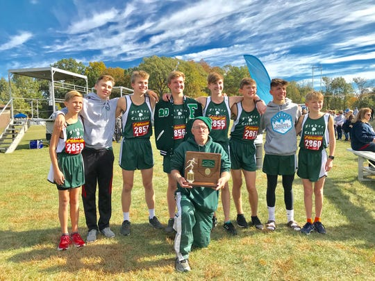 The Fisher Catholic boys' cross country team finished as Central District Division III runner-up during Saturday's district cross country meet at Hilliard Darby High School.