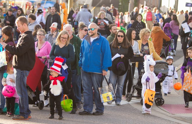 Trick-or-treaters pack downtown Howell for Legend of Sleepy Howell, Saturday, Oct. 19, 2019. This year's event will be a drive-thru experience due to the pandemic.