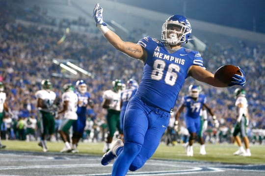 Memphis tight end Joey Magnifico scores a touchdown during the first half of their game against Tulane at the Liberty Bowl Memorial Stadium on Saturday, Oct. 19, 2019.