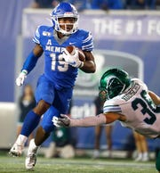 Memphis running back Kenneth Gainwell breaks past Tulane defender Chase Kuerschen during Saturday's game.