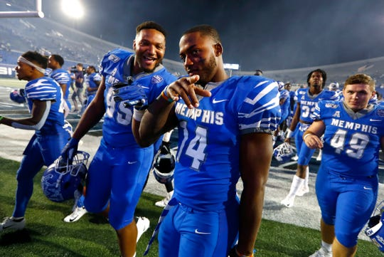 Memphis defensive lineman Keith Brigham, left, and Antonio Gibson are all smiles after their 47-17 win against Tulane at the Liberty Bowl Memorial Stadium on Saturday, Oct. 19, 2019.