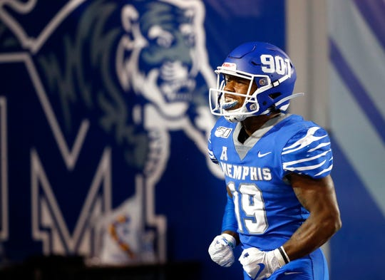 Memphis running back Kenneth Gainwell celebrates a touchdown against Tulane on Saturday.