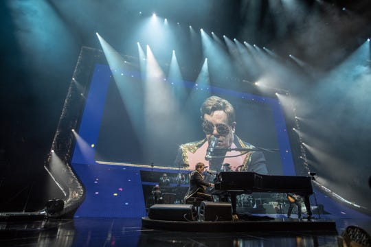Elton John performs at a sold-out Fiserv Forum in Milwaukee on Oct. 19, 2019.
