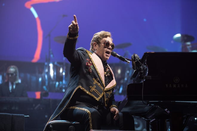"Elton John performs at Fiserv Forum on Oct. 19, 2019, for his ""Farewell Yellow Brick Road"" goodbye tour. Sir Elton's return show won't be until 2022."