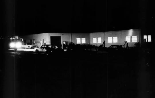 Investigators search for evidence outside Kenworth Manufacturing Co. in Menomonee Falls on the night of Diane Olkwitz's murder, Nov. 3, 1966.