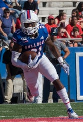 Louisiana Tech's Amik Robertson (21) runs the ball after intercepting a pass by Southern Miss during the game at Joe Aillet Stadium in Ruston, La. on Oct. 19.
