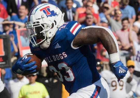 Louisiana Tech's Justin Henderson (33) runs the ball for a 30 yard touchdown, Tech's first in the game against Southern Miss at Joe Aillet Stadium in Ruston, La. on Oct. 19.
