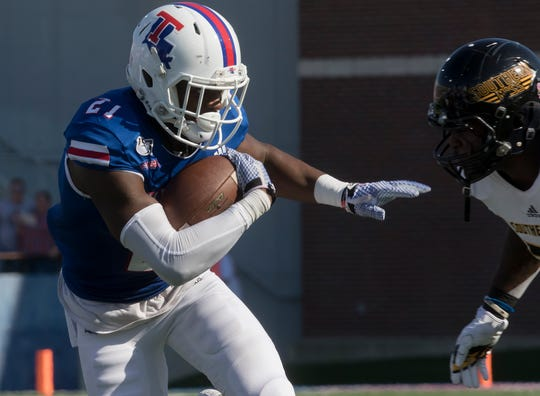 Louisiana Tech's Amik Robertson (21) looks to stiff arm a Southern Miss player after intercepting a pass during the game at Joe Aillet Stadium in Ruston, La. on Oct. 19.