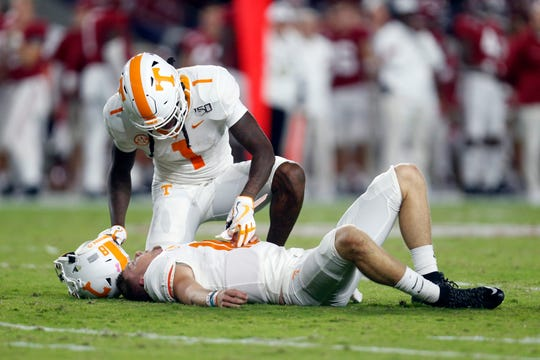 Oct 19, 2019; Tuscaloosa, AL, USA; Tennessee Volunteers wide receiver Marquez Callaway (1) checks on quarterback Brian Maurer (18) after a hit during the first half of an NCAA football game at Bryant-Denny Stadium. Mandatory Credit: Butch Dill-USA TODAY Sports