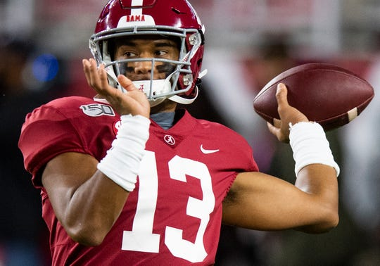Alabama quarterback Tua Tagovailoa (13) warms up before the Alabama vs. Tennessee game at Bryant Denny Stadium in Tuscaloosa, Ala., on Saturday October 19, 2019.