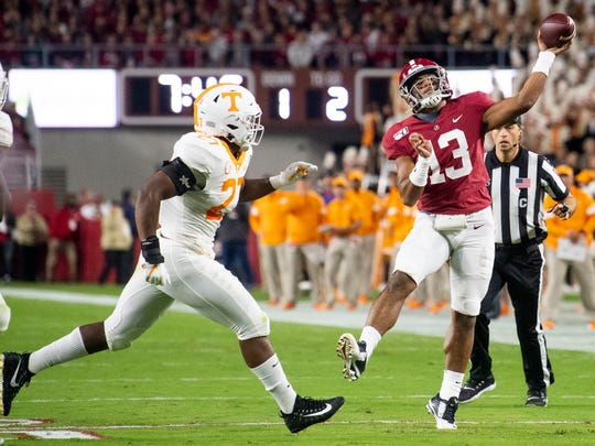 Alabama quarterback Tua Tagovailoa (13) throws an interception against Tennessee at Bryant-Denny Stadium in Tuscaloosa, Ala., on Saturday October 19, 2019.
